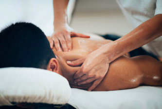 therapist doing a therapeutic massage to a man